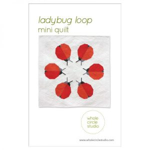 Ladybug Loop is a graphic wallhanging / mini quilt that uses foundation paper piecing techniques. Make additional blocks to make a larger quilt (layout ideas are provided to make a lap, twin or queen quilt). This tested pattern contains both detailed instructions and diagrams, making it easy to piece. Pattern by Whole Circle Studio.