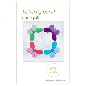 Butterfly Bunch is a fun graphic wallhanging / mini quilt that uses foundation paper piecing techniques. Make additional blocks to make a larger quilt (layout ideas are provided to make a lap, twin or queen quilt). This tested pattern contains both detailed instructions and diagrams, making it easy to piece. Each butterfly block measures 14″ x 14″ making it a flexible design to customize your own quilting project. Use what you have in your fabric stash, fat eighths or fat quarters for the butterflies. Just add yardage for the background! Pattern by Whole Circle Studio.