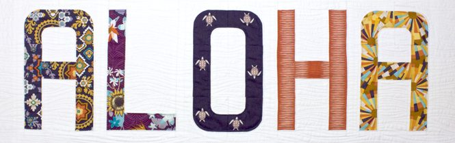 "Aloha mini quilt made with Typecast, an English Paper Piecing (EPP) Pattern Make all 26 letters of the alphabet. Each block measures approximately 6"" x 9"". This fully tested pattern guide contains detailed instructions, tips and diagrams to walk quilters through the variety of EPP straight line and curved piecing skills they will use while making Typecast blocks. Required English Paper Pieces and optional acrylic templates not included. Pattern by Whole Circle Studio"