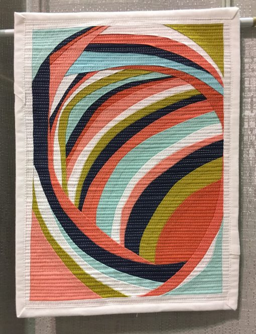 "Modern quilt featured at QuiltCon 2019 —""Self portrait"" by Melanie Tuazon @melintheattic Statement: ""The result of an improv curve process that I found revelatory and exhilarating."""
