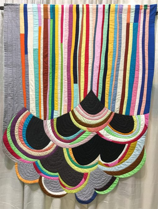"Modern quilt featured at QuiltCon 2019 — ""Rainbow Cloud"" by Sherri Lynn Wood @sherrilynnwood Statement: ""Freestyle patchwork with ruler-free strip piecing and bias strip piecing on the curve, inspired by the bright colors, complexity of line, and unexpected juxtaposition in the grafitti-rich environment of industrial east Oakland, California."