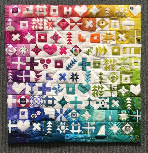 "Modern quilt featured at QuiltCon 2019 — ""100 Days of Sewing Smaller"" by Kitty Wilkin @nightquilter Statement: ""My personal challenge was #100daysofsewsmaller. Each of the 100 blocks in this challenge finishes at 1.25"" square, and these blocks were eventually made into the mini quilt you see here. The accompanying photos highlight each individual piece, showing the process of creating each tiny block."