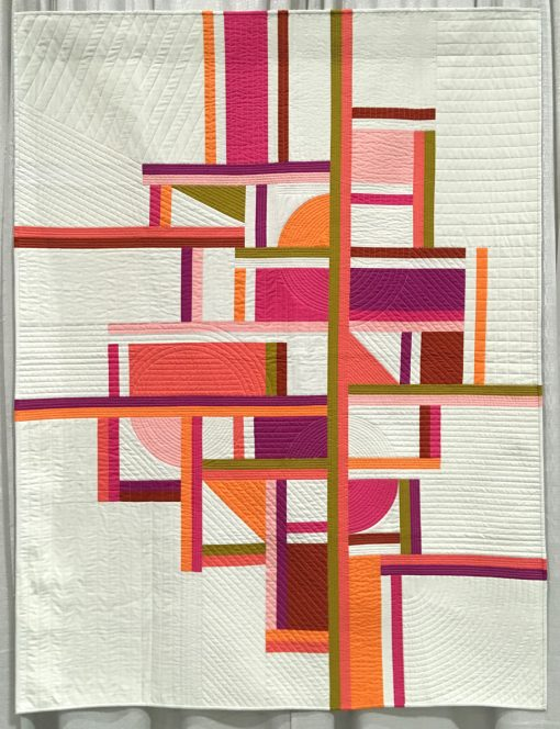 "Modern quilt featured at QuiltCon 2019 — ""Geometry Lesson"" by Jayne Willis @twiggyandopal Statement: ""This quilt was inspired and designed specifically for this color palette. The colors were influenced by a recent trip to 'Lauderdale by the Sea' with my daughter. The colors engulf you with a relaxing warmth that only a tropical setting in winter could! Getting all the parts and pieces of the geometric shapes to intermix in a cohesive design was my main focus. Showcasing the color palette was also a big factor in my design."""