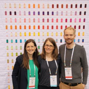 QuiltCon 2016. Erin & Bradley of Aurifil USA with Sheri Cifaldi-Morrill of wholecirclestudio.com, designer and maker of quilt.