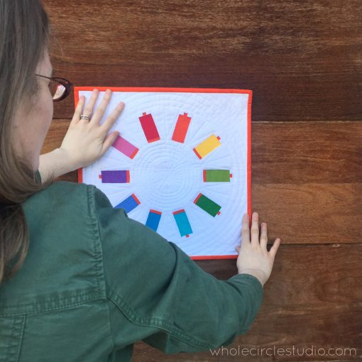 Sew Many Colors — a free foundation paper piecing pattern that makes a mini quilt. Choose your favorite colors and get sewing! Makes a great wall hanging for your sewing studio.