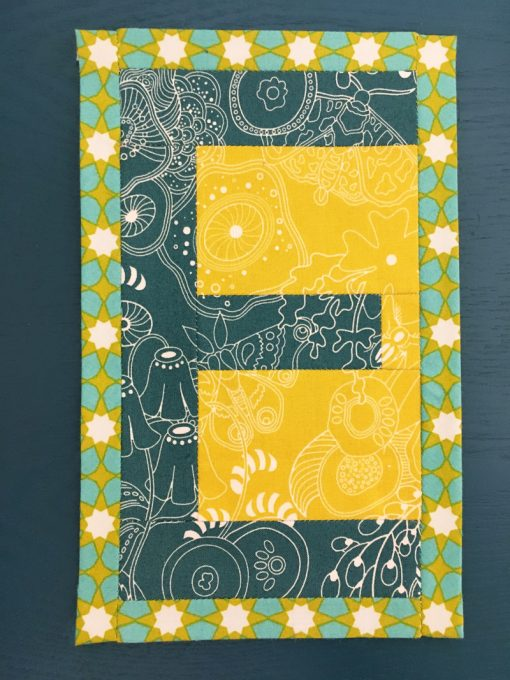 E English Paper Piecing EPP Alphabet Modern Mini Quilt made by Erin Bay, Paper Piecies of Paducah using Alison Glass Sunprint fabric and Typecast EPP pattern.