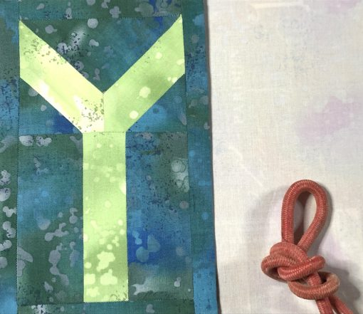 Letter Y English Paper Piecing EPP Alphabet modern quilted block made by Debby Brown using Typecast EPP pattern.