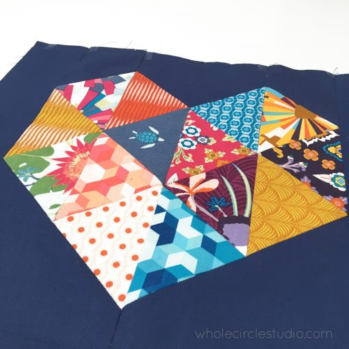 English Paper Pieced heart with Aura Fabric by Mister Domestic.