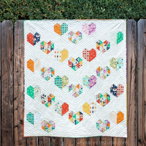 Love at First Sight, an easy foundation paper piecing quilt pattern. Fat Quarter bundle friendly! Pattern available at www.wholecirclestudio.com
