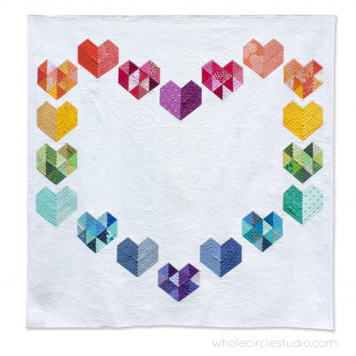 Love at First Sight, an easy foundation paper piecing quilt pattern. Scrap and rainbow palette friendly! Pattern available at www.wholecirclestudio.com
