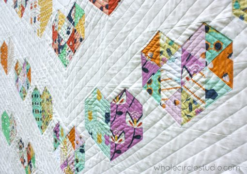 detail of Love at First Sight, an easy foundation paper piecing quilt pattern. Fat Quarter bundle friendly! Pattern available at www.wholecirclestudio.com