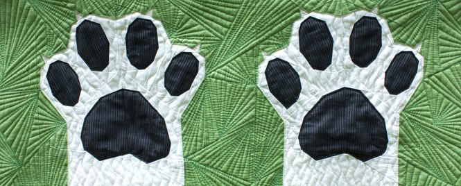 detail of Paws Up! an intermediate foundation paper pieced quilt pattern celebrating dogs and cats. Pattern makes 4 sizes—Mini, Throw, Twin and Queen. Pattern available at www.wholecirclestudio.com — Mini sample shown made with Redux by Giuseppe Ribaudo (AKA Giucy Giuce) for Andover Fabrics. Pieced and quilted with Aurifil Cotton thread.