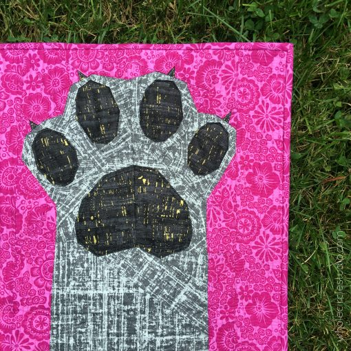 Paws Up! an intermediate foundation paper pieced quilt pattern celebrating dogs and cats. Pattern makes 4 sizes—Mini, Throw, Twin and Queen. Pattern available at www.wholecirclestudio.com