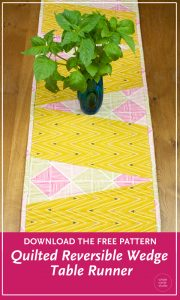 Make a cute quilt table runner. Get the free pattern to make this reversible wedge runner. Designed by Whole Circle Studio.