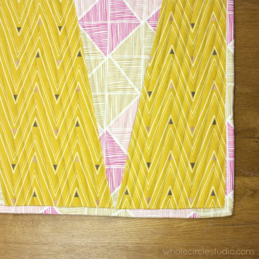 detail of free quilting pattern for a reversible wedge table runner, made with Art Gallery Fabrics canvas. Designed and made by Sheri Cifaldi-Morrill of Whole Circle Studio