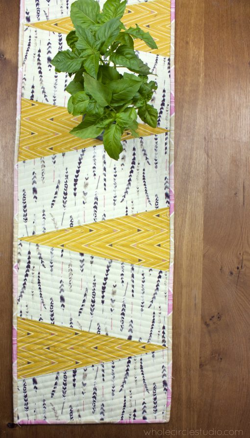 free quilting pattern for a reversible wedge table runner, made with Art Gallery Fabrics canvas. Designed and made by Sheri Cifaldi-Morrill of Whole Circle Studio