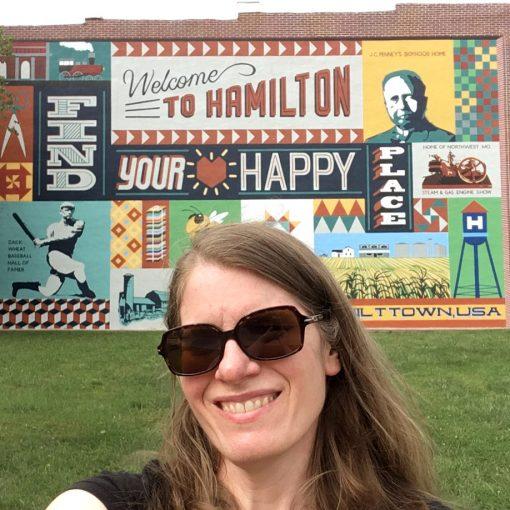 Sheri Cifaldi-Morrill visiting the main mural in Hamilton, Missouri—home of Missouri Star Quilt Company