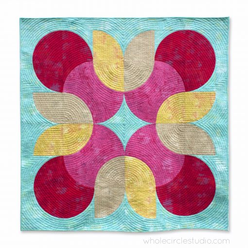 Tulip Twist, a modern drunkards path quilt pattern made with Moda Grunge. Designed by Sheri Cifaldi-Morrill of Whole Circle Studio. Available exclusively to Missouri Star Academy students.