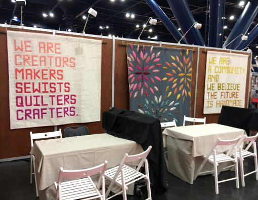 Makers' Manifesto quilt made with Typecast foundation paper piecing pattern by Whole Circle Studio, with Art Gallery Fabrics PURE Solids and Aurifil 50wt cotton thread. Shown at International Quilt Market 2019 in Houston.