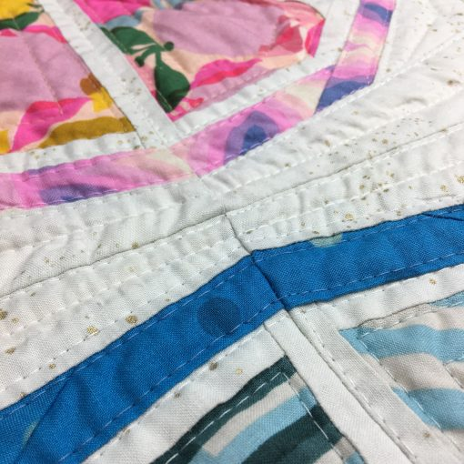 detail of quilting with Aurifil 40wt on Citrus Slices, a fun modern foundation paper piecing quilt pattern. Designed by Sheri Cifaldi-Morrill of Whole Circle Studio