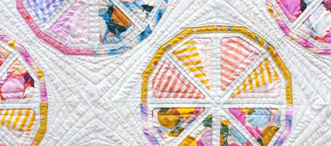 detail of Citrus Slices, a fun modern foundation paper piecing quilt pattern. Designed by Sheri Cifaldi-Morrill of Whole Circle Studio
