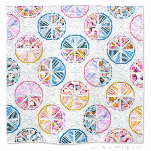 Citrus Slices, a fun modern foundation paper piecing quilt pattern. Designed by Sheri Cifaldi-Morrill of Whole Circle Studio