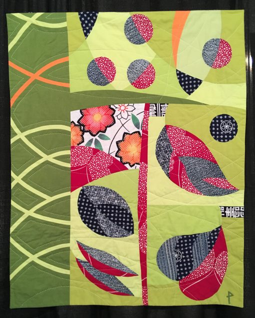 """Leaf & Berry"" by Patricia Belyea <br>Statement: ""The quilt design was created with five unrelated and lyrical quilt blocks where I played with color and design. The first block was the heart-shaped leaf on the bottom right. From there, I responded to the existing shapes and colors to make the next block. The dashed quilting was stitched with a Sashiko 2 machine."" [Design Source: This was inspired by nature and an interest in exploring complex curved piecing. 