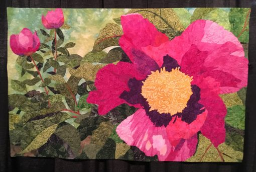 """Firelight Peony"" by Barbara Persing <br>Statement: ""This quilt is based on a photo I took at the Denver Botanical Gardens. The construction of this quilt is done with glue-basted-raw-edge applique. There is no fusible web in this quilt. All of the thread work was done with Aurifil 40wt and 50wt cotton thread. I used over 56 colors in this quilt."" [Design Source: Personal photograph 