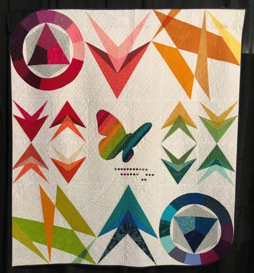"""Neoteric"" by Sarah Thomas <br>Statement: ""This quilt was developed using the fabric collection, Avant Garde, by Katarina Rocella as inspiration. It includes a range of techniques. Color theory, foundation paper piecing, applique, and translucency all play an important part in this pattern."" [Design Source: Inspired by the fabric collection, Avant Garde, by Katarina Rocella 
