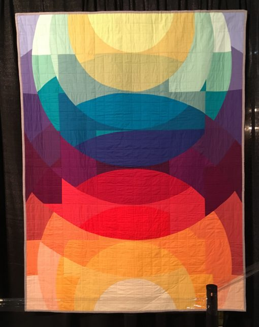 """Sonder"" by Melissa Mason Statement: ""My quilt was inspired by graphic artist Andy Gilmore. Sonder celebrates the comples and varied paths we all walk and the richness that can be found there. It was conceptualized while recording the oral histories of women who are often overlooked by history. It is designed to keep the eye constantly moving and following new pathways."" [Design Source: Original Design 