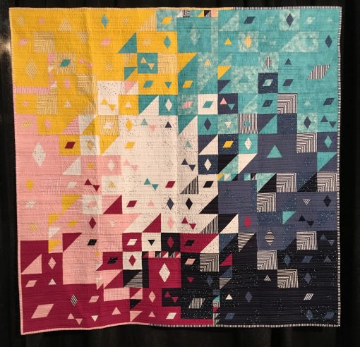 """Blossom Burst"" by Sarah Lefebvre Statement: ""Blossom Burst is an original quilt design created for the 2019 Riley Blake Designs Modern Quilt Guild Fabric Challenge. I used geometric shapes: triangles, diamonds, and parallelograms paired with organic straight-line quilting to add contrast, texture, and interest.."" [Design Source: Original Design 