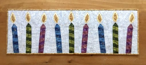 Celebrations Candles is an easy, quick quilt block to make. I made multiple blocks to make a winter themed table runner. This foundation paper pieced pattern is scrap friendly!