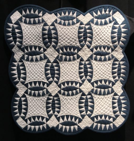 Pickle Dish by Andrea Blackhurst. Techniques: Machine pieced and quilted. Design Source: Miniature Quilts Magazine #35. Photo taken at 2019 International Quilt Festival