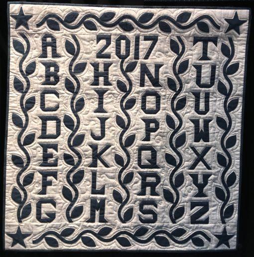 Alphabet Quilt by Andrea Blackhurst. Techniques: Hand appliqued, machine pieced and quilted. Design Source: Antique quilt. Photo taken at 2019 International Quilt Festival