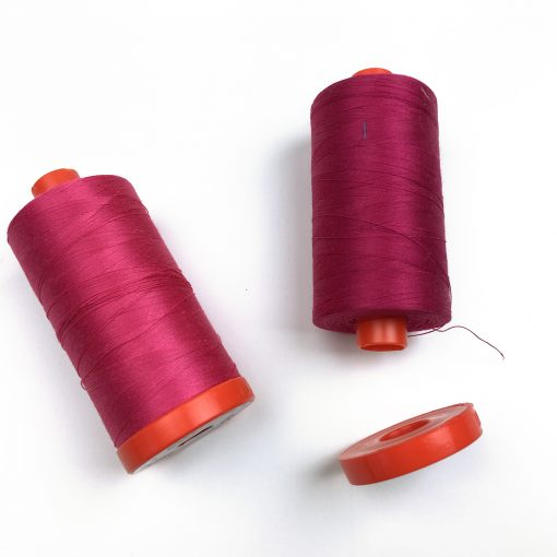 Looking to keep the ends of your Aurifil thread neat and tidy? Did you know you can remove the flange on the bottom of your large spool? Remove it and tuck the end of your thread in!