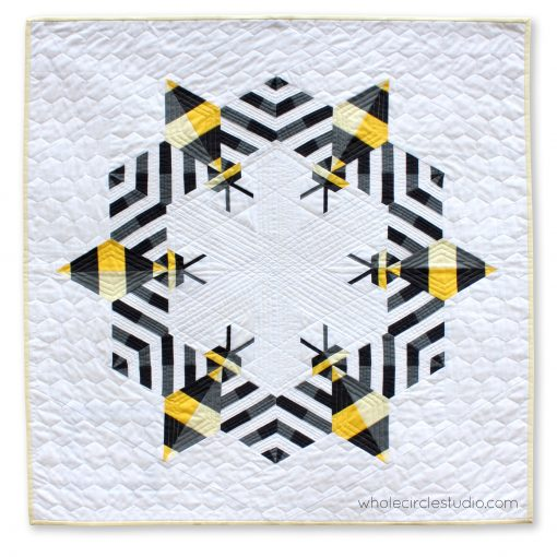 Bzzzzzz is an award-winning modern, graphic wallhanging/mini quilt featuring a combination of traditional machine piecing and foundation paper piecing. Make additional blocks to make a larger quilt (layout ideas are provided to make a lap, twin or queen quilt). This tested pattern contains both detailed instructions and diagrams, making it easy to piece.
