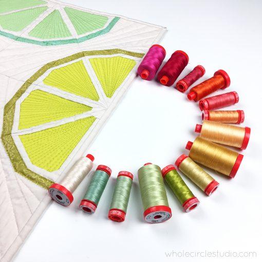 Selecting a beautiful rainbow Aurifil cotton thread color palette for my Citrus Slices quilt blocks