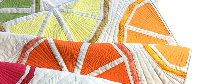 Citrus Slices quilt table runner by Whole Circle Studio