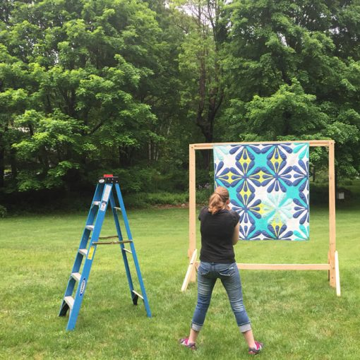 Sheri Cifaldi-Morrill photographing quilts