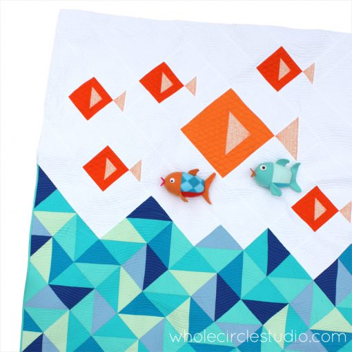 An easy, cute, modern fish quilt using half square triangles (HSTs) and strips. Little Fishies quilt pattern by Whole Circle Studio.