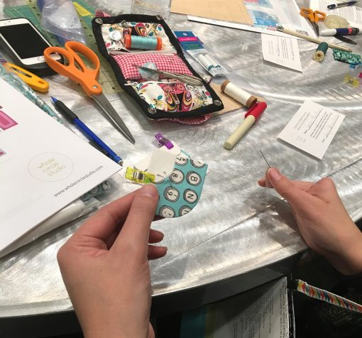 Quilt students practicing English Paper Piecing in Sheri Cifaldi-Morrill's EPP workshop at QuiltCon 2020