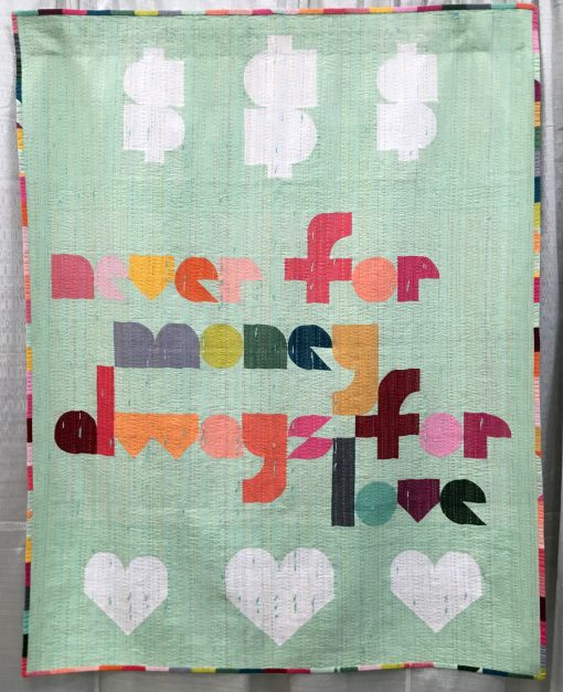 """""""Naive"""" by Laura Hartrich @laurahartrich Statement: """"Words from a favorite song, and an unofficial, cheeky motto for my quilt making. Quilters know that people are constantly asking if you sell your quilts, and then reacting with shock when you name a price. Here is another possible way to answer. I think it's more polite than, 'You can't afford me.'"""" Modern quilt featured in the Handwork category at QuiltCon 2020 in Austin, Texas presented by the Modern Quilt Guild."""