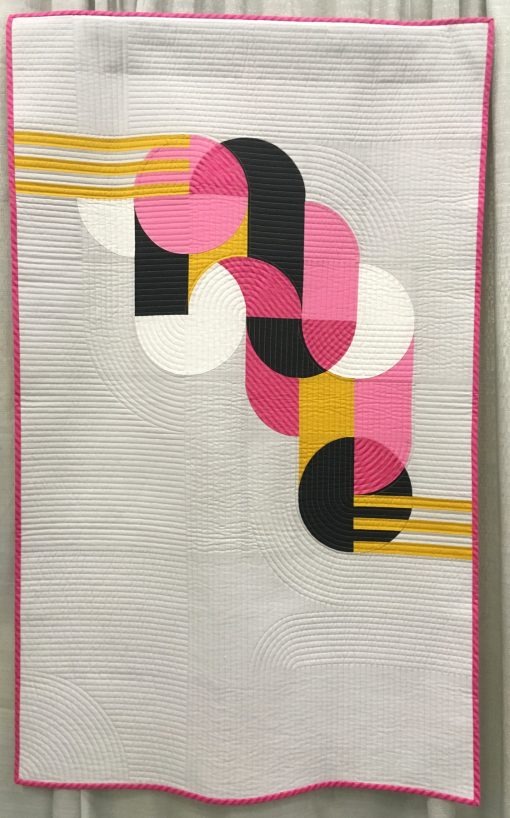 """Bubble Gum"" by Sophie Zaugg @lunalovequilts Awarded 2nd place in Use of Negative Space category Statement: ""The design was inspired by a geometric street art mural. I included the main motif in negative space to showcase it and mimic the concrete wall of the original work. I placed the yellow strips as if they linked the motif to the edge of the quilt. All the curves are hand appliquéd."" Modern quilt featured in the Use of Negative Space category at QuiltCon 2020 in Austin, Texas presented by the Modern Quilt Guild."