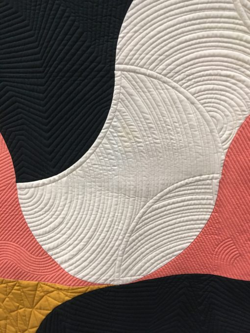 """detail of """"Finding Flow"""" by Jen Carlton Bailly @bettycrockerass Quilted by Christine Perrigo Statement: """"Directions pulling Discombobulates my mind Deep breathe find the flow"""" Modern quilt featured in the Minimalist Design category at QuiltCon 2020 in Austin, Texas presented by the Modern Quilt Guild."""