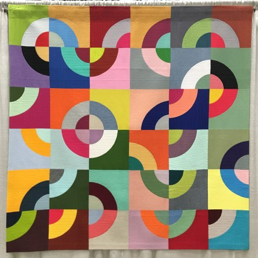 """""""Art 140: Intro to Sculpture"""" by Laura Hartrich @laurahartrich Quilted by Gina Pina Statement: """"This quilt was the result of an assignment for the undergrad sculpture class I took in 2017. The goal was to make something the audience could interact with. Inspired by Sol LeWitt's wall drawings, I made these blocks that my fellow students could arrange in a grid. I invited them to think about how the colors were interacting and about creating a compelling pattern. Eventually I pieced them together as my classmates arranged them."""" Modern quilt featured in the Modern Traditionalism category at QuiltCon 2020 in Austin, Texas presented by the Modern Quilt Guild."""