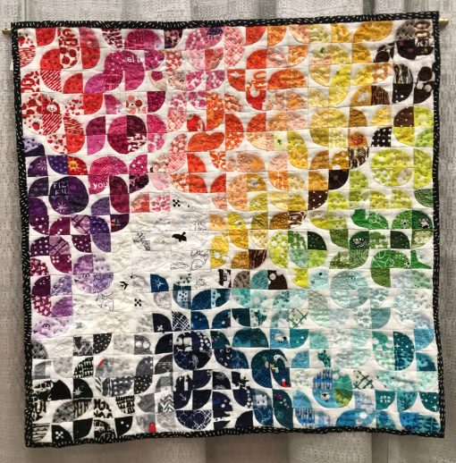"""Curvelets"" by Jen Carlton Bailly @bettycrockerass Statement: ""Teeny tiny bits Focuse order and routine Present mind calming"" Modern quilt featured in the Small Quilts category at QuiltCon 2020 in Austin, Texas presented by the Modern Quilt Guild."