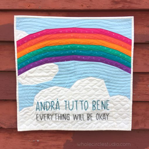 "Andrà Tutto Bene (Everything Will Be Okay in English) is a free foundation paper piecing pattern (FPP) and was inspired by the words and beautiful artwork created by children in Italy during the Covid19 pandemic in 2020. While children and their families in Italy were quarantined in their homes, many displayed rainbow-themed banners and posters featuring the phrase ""Andrà Tutto Bene"" to send messages of hope and positivity. We encourage you to make this mini quilt to display in the window of your own home or sewing space. Make one for yourself, for a friend, or even for your local quilt shop. Share hope."