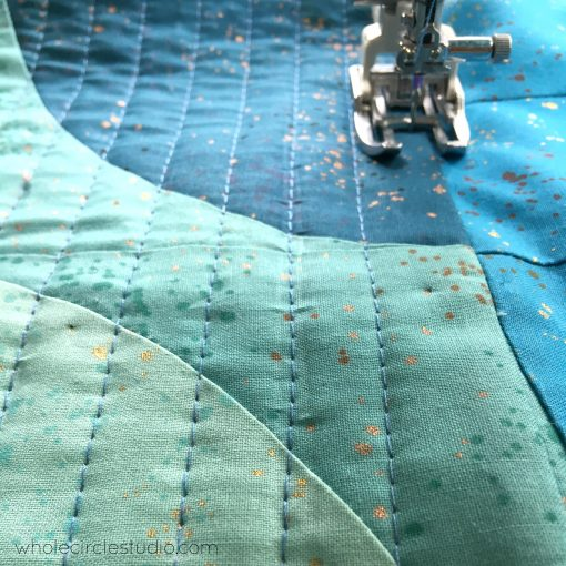 Quilting with the EvenFeed foot on a Janome 6700p on my Big Island Sky throw quilt.