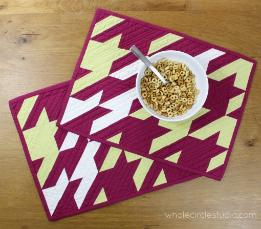Make these placemats to spruce up your dining table. Keep them for yourself or make them as a gift (or make two sets: one to keep and one to give)! These placemats, inspired by the classic houndstooth print, are comprised of half square triangles. This tested pattern contains detailed instructions and diagrams, making it easy to piece. Works well with prints, solids or a combination of both.