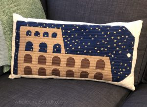 Colosseum (Rome, Italy) quilt block made into a decorative throw pillow. Foundation paper piecing (FPP) pattern, part of Around the World Block of the Month Quilt Sew Along